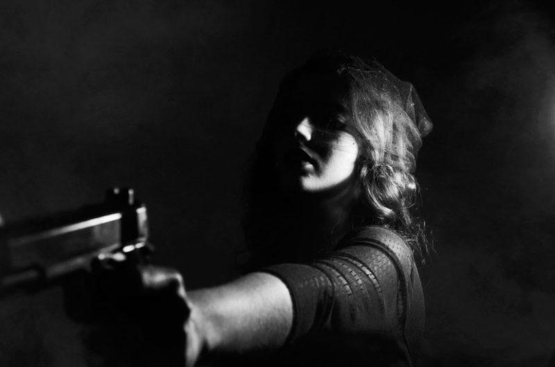 Criminal Conviction - Woman with Gun
