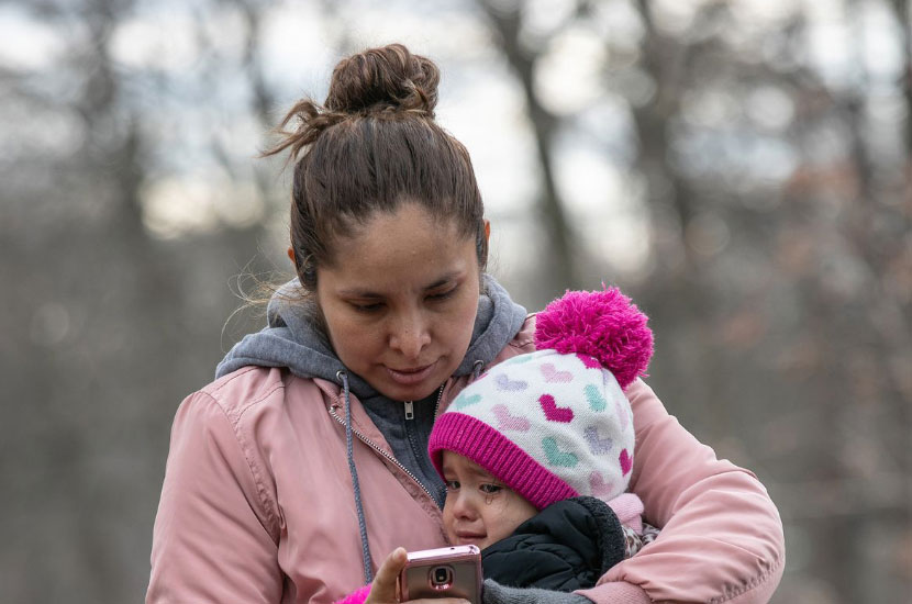 Mother And Child Wait For Day In Immigration Court