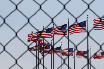 US Flags behind fence
